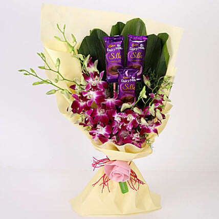Elegant Dairy Milk & Orchids Bouquet: Cadbury Chocolates