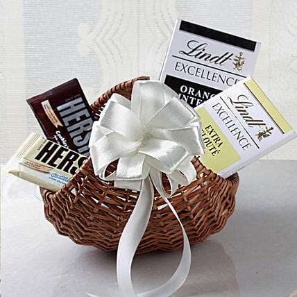 Lindt Chocolates Cane Basket Hamper: Send Gift Hampers