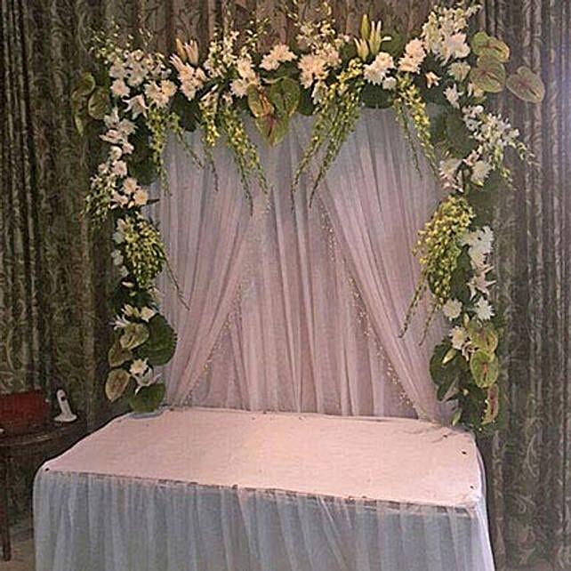 Pristine Ganpati Floral Decoration: Send Carnations
