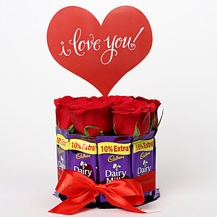 Red Roses in Glass Vase & Dairy Milk Arrangement: Buy Flowers Combo