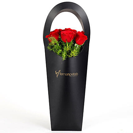 Red Roses in Stylish Black Sleeve: Flowers for Anniversary