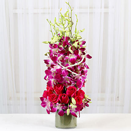 Roses And Orchids Vase Arrangement: Gifts Delivery In Ahirtoli