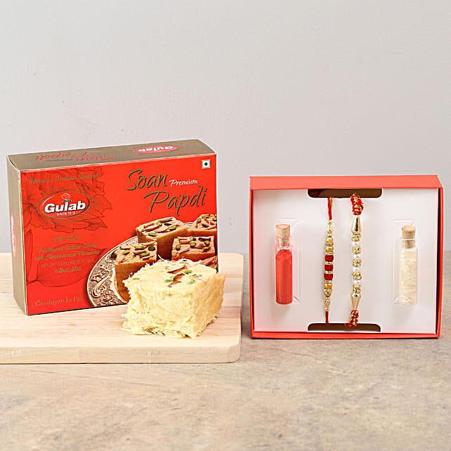 Set of 2 Rakhis & 200 gms Soan Papdi Combo: Raksha Bandhan Sweets