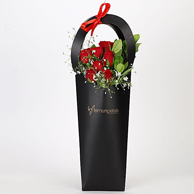 Ravishing Red Roses in Black Sleeve: Send Flowers to Vadodara